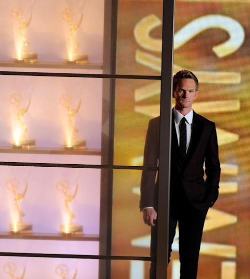 Neil Patrick Harris appears on stage at the 65th Primetime Emmy Awards at the Nokia Theatre, Sunday, Sept. 22, 2013, in Los Angeles. (Photo by Chris Pizzello/Invision/AP)