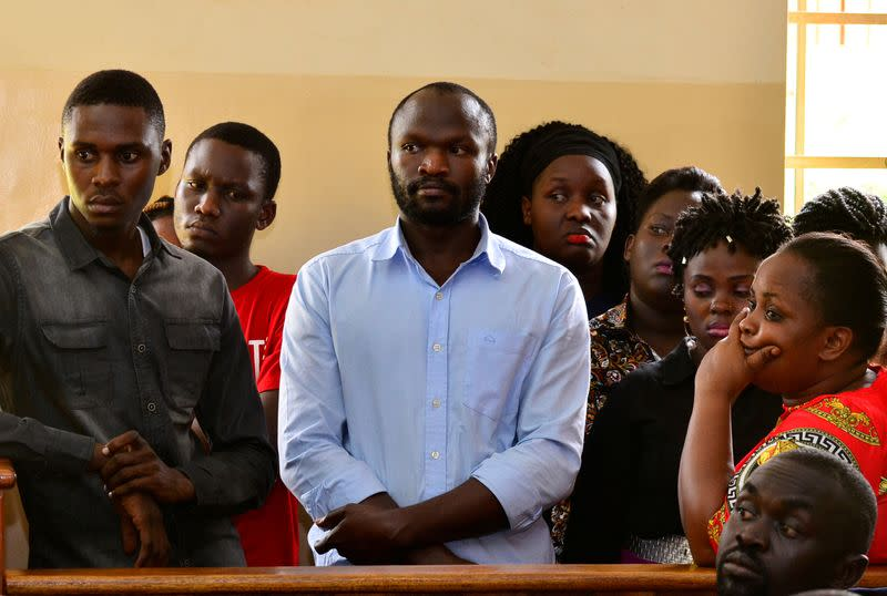 Ugandan independent filmmaker Moses Bwayo stands in the dock at the Makindye Magistrate Court in Makindye division of Kampala