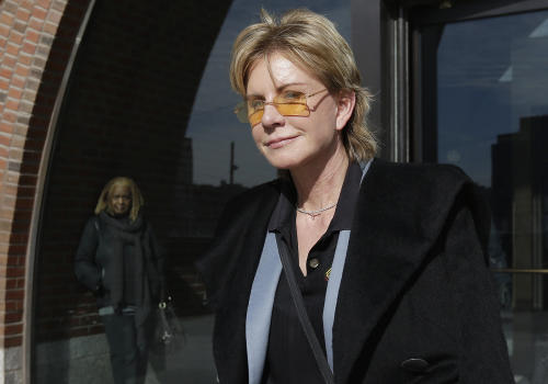 Author Patricia Cornwell leaves federal court in Boston, Thursday, Feb. 7, 2013, after she took the stand in her lawsuit against her former financial management company. Cornwell claims that the firm and a former executive cost her millions of dollars in losses or unaccounted revenue during their four-year relationship. (AP Photo/Steven Senne)