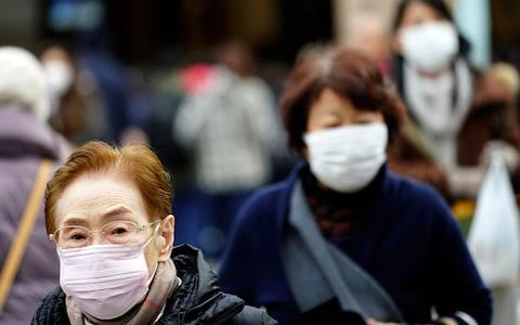 A man has now tested positive for the new virus in Japan after returning from China - Credit: Eugene Hoshiko/AP