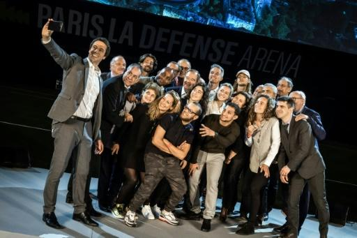 Tony Estanguet, the head of the Paris 2024 organising committee, poses with breakdancing, skateboarding, climbing and surfing athletes