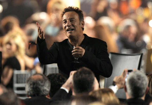 Honoree Bruce Springsteen gestures to attendees at the MusiCares Person of the Year tribute at the Los Angeles Convention Center on Friday Feb. 8, 2013, in Los Angeles. (Photo by Chris Pizzello/Invision/AP)
