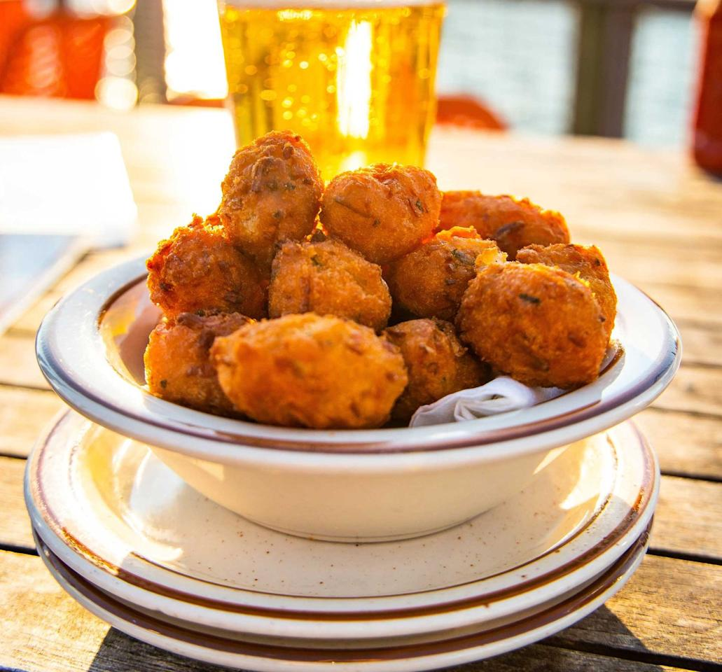 "<p>Yes, these taste as cute as they sound. A small, savory, <a href=""https://www.countryliving.com/food-drinks/g2022/state-fair-food-recipes/"" target=""_blank"">deep-fried</a> sphere that consists of cornmeal-based batter. Usually served as a side dish with seafood, they'll immediately take you back to a breezy summer night in <a href=""https://www.hiltonheadisland.org/"" target=""_blank"">Hilton Head</a>, sitting on the dock for dinner and drinks.</p><p><strong>Get the recipe at <a href=""https://www.foodnetwork.com/recipes/paula-deen/hushpuppies-recipe-1912936"">Food Network</a>.</strong></p>"