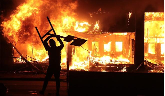 A building burns during a protest in Minneapolis. Photo: AFP