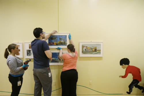 In this Wednesday, July 10, 2013 photo, perorations are made for The Snowy Day and The Art Of Ezra Jack Keats exhibition at the National Museum of American Jewish History, in Philadelphia. The exhibition opened July 19. (AP Photo/Matt Rourke)
