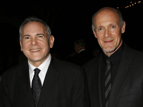 "FILE - This Nov. 15, 2007 file photo shows Craig Zadan, left, and Neil Meron, producers of the film ""Hairspray"" at the Santa Barbara International Film Festival's Kirk Douglas Award for Excellence in Film presented to actor John Travolta in Santa Barbara, Calif. Zadan and Meron will produce the Oscars again. The film academy announced Tuesday, April 17, 2013, that it has invited Zadan and Meron to return for the 2014 Academy Awards telecast. (AP Photo/Michael A. Mariant, file)"
