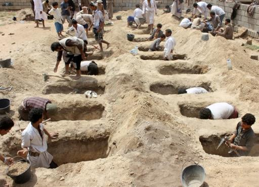 Yemenis dig graves last month for children who were killed when their bus was hit during a Saudi-led coalition air strike