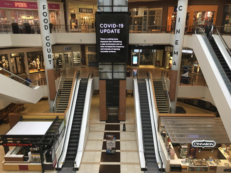 Few shoppers were in the St. Louis Galleria on Thursday, March 19, 2020. Most stores were shuttered. (Robert Cohen/St. Louis Post-Dispatch via AP)