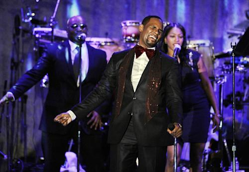 FILE - This Feb. 12, 2011 file photo shows R. Kelly performing at the pre-Grammy gala & salute to industry icons with Clive Davis honoring David Geffen in Beverly Hills, Calif. Kelly is up for the Ashford & Simpson songwriter's award and album of the year, at this year's Soul Train Awards, bringing his career total to 21. He's the most nominated act ever, but he'll have to battle Usher, who leads with five. (AP Photo/Mark J. Terrill, file)