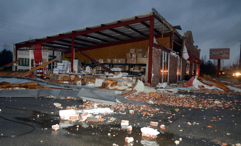 A business at 5133 Lincoln Road Extension in Hattiesburg, Miss., is damaged after an apparent tornado Sunday, Feb. 10, 2013. Major damage was reported in Hattiesburg and Petal, including on the campus of the University of Southern Mississippi. (AP Photo/Chuck Cook)