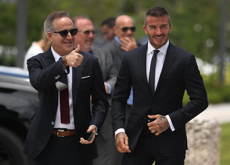 MIAMI, FL - JULY 12: Jorge Mas (L) and David Beckham arrive for a rally being held next to Miami City Hall in support of building a Major League Soccer stadium on July 12, 2018 in Miami, Florida. Mr. Beckham and his partners were planning on going before the City of Miami for a public hearing in their effort to build a Major League Soccer stadium in the City of Miami for their professional soccer team. (Photo by Joe Raedle/Getty Images)