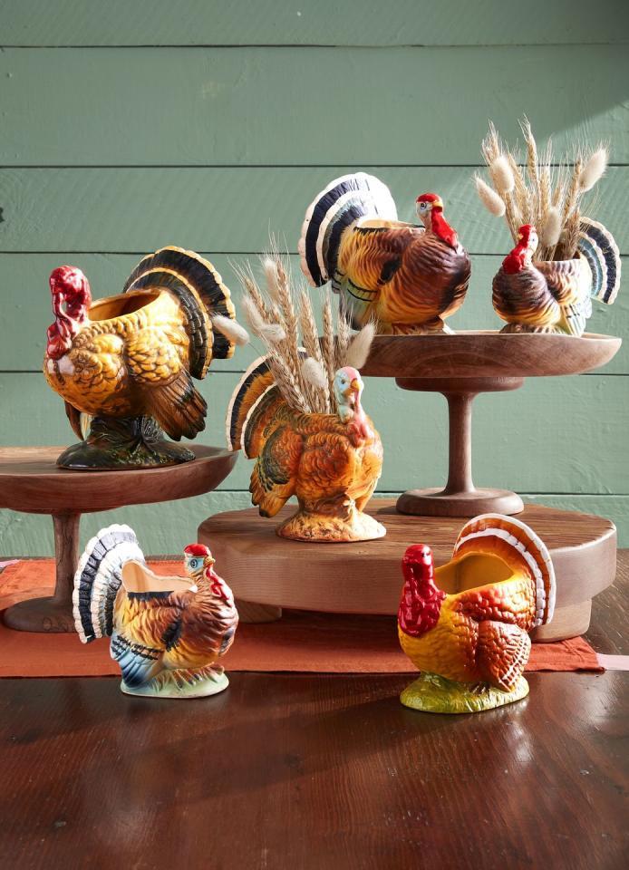 "<p>These festive vessels are perfect for a Thanksgiving centerpiece. Fill them with rustic wheat for a finishing touch. </p><p><a class=""body-btn-link"" href=""https://www.amazon.com/Natural-Sheaves-Autumn-Arrangements-17inch/dp/B08BYGM838/ref=sr_1_1_sspa?dchild=1&keywords=wheat&qid=1602637296&sr=8-1-spons&psc=1&spLa=ZW5jcnlwdGVkUXVhbGlmaWVyPUEyT0RPVjJCNkFBQUZHJmVuY3J5cHRlZElkPUEwODc3NTc0MzRITENEQUE0SlBJMCZlbmNyeXB0ZWRBZElkPUEwOTA1NDIwMVdOOVBMU0dZMTFIVCZ3aWRnZXROYW1lPXNwX2F0ZiZhY3Rpb249Y2xpY2tSZWRpcmVjdCZkb05vdExvZ0NsaWNrPXRydWU%3D&tag=syn-yahoo-20&ascsubtag=%5Bartid%7C10050.g.1371%5Bsrc%7Cyahoo-us"" target=""_blank"">SHOP WHEAT</a></p>"