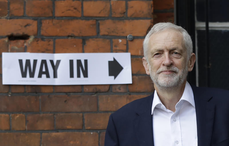Jeremy Corbyn leader of Britain's opposition Labour Party leaves a polling station after voting in the European Elections in London, Thursday, May 23, 2019. (AP Photo/Kirsty Wigglesworth)