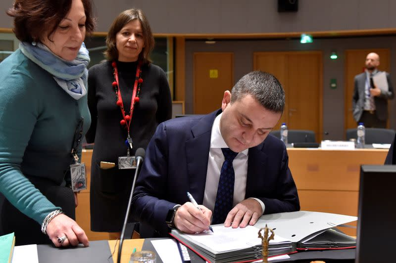 FILE PHOTO: Bulgaria's minister of finance Vladislav Goranov signs documents as he attends a European Union finance ministers meeting in Brussels
