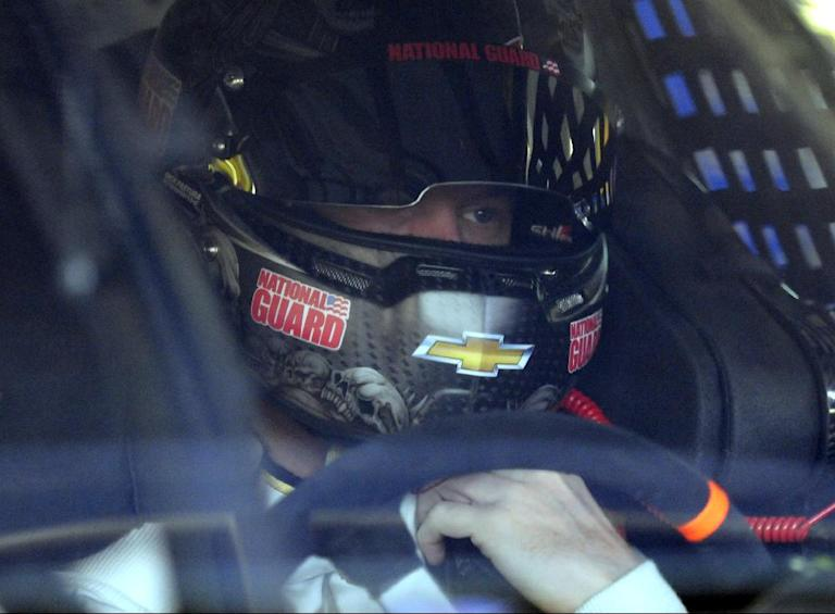 Dale Earnhardt Jr waits in his car before practice for Sunday's NASCAR Sprint Cup series Coca-Cola 600 auto race at Charlotte Motor Speedway in Concord, N.C., Saturday, May 24, 2014. (AP Photo/Mike McCarn)