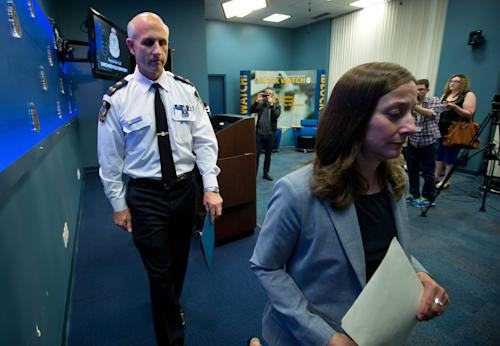 """Vancouver Police Acting Chief Doug LePard, left, and British Columbia Chief Coroner Lisa Lapointe leave a news conference after announcing the death of Canadian actor Cory Monteith in Vancouver, British Columbia, late Saturday, July 13, 2013. Vancouver police say Canadian born actor Montieth, star of the hit show """"Glee"""" has been found dead in city hotel. (AP Photo/The Canadian Press, Darryl Dyck)"""