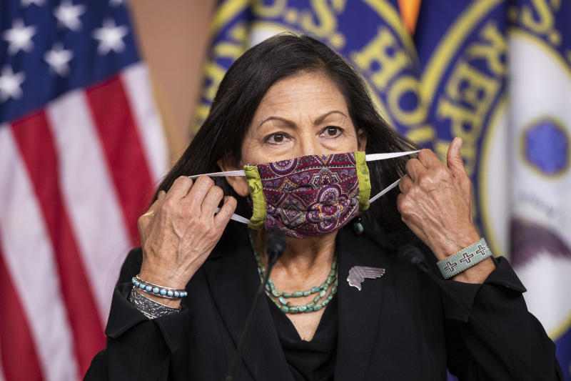 Rep. Debra Haaland, D-N.M. removes her face mask to speak during a news conference on Capitol Hill, Wednesday, May 27, 2020, in Washington. (AP Photo/Manuel Balce Ceneta)