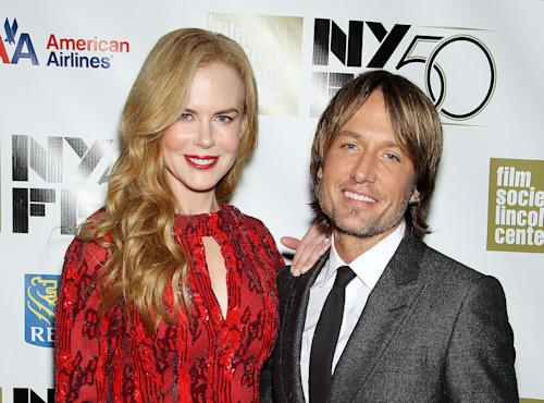 "This image released by Starpix shows actress and honoree Nicole Kidman, left, and her husband Keith Urban at a gala by The Film Society of Lincoln Center following by the premiere of her film, ""The Paperboy"" at the 2012 New York Film Festival at Alice Tully Hall, Wednesday, Oct. 3, 2012 in New York. Urban, a judge on the singing competition series ""American Idol,"" has become more than just a judge: he's also the pacifier on the newly-minted panel. A blurry web video released Tuesday by TMZ.com shows an argument between fellow judges Nicki Minaj and Mariah Carey and Urban seated between them. ""We're all passionate people and we're learning a new dance and we're all a work in progress,"" Urban said Wednesday at the New York Film Festival gala honoring his wife. When asked what it feels like to be stationed between the dueling divas , Urban said, ""Best seat in the house."" (AP Photo/Starpix, Marion Curtis)"