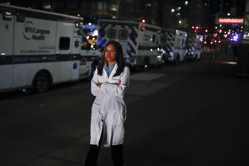 CORRECTS SPELLING TO DOOBAY INSTEAD OF DOOBEY ON SECOND REFERENCE - Kamini Doobay, an Emergency Medicine Resident physician at NYU Langone Medical Center and Bellevue Hospital, talks during an interview about her experiences treating COVID-19 patients, Thursday, March 26, 2020, in New York. As an emergency medicine physician in New York City, Dr. Doobay has always known that death is part of the territory in trying to care for the city's sickest. But it hasn't been like this _ patients stricken with coronavirus, on ventilators, and no visitors allowed because of strict protocols to prevent its spread. (AP Photo/John Minchillo)