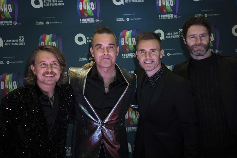 Take That band members, from left, Mark Owen, Robbie Williams, Gary Barlow and Howard Donald pose for photographers upon arrival at the premiere of the musical 'The Band', in London, Tuesday, Dec. 4, 2018. (Photo by Vianney Le Caer/Invision/AP)