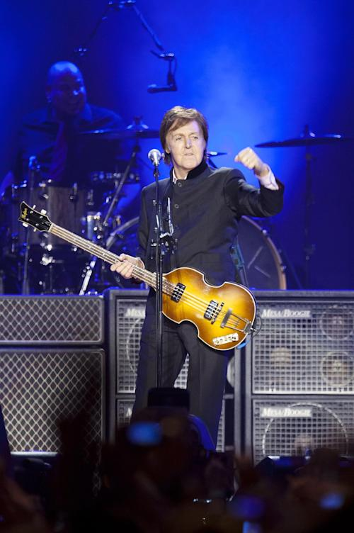 "FILE - In this Wednesday, Dec. 14, 2011 file photo, Sir Paul McCartney performs on stage during his ""Good Evening Europe"" European Tour, his first since 2003, at Olympic Hall in Moscow, Russia. Former Beatle Paul McCartney has asked a Russian judge to release members of the Pussy Riot punk group from prison. In letters dated Monday and posted online by the group's supporters, McCartney asks for parole to be granted to Maria Alekhina and Nadezhda Tolokonnikova, currently serving two-year sentences for an impromptu protest in Moscow's main cathedral. (AP Photo/Alexander Zemlianichenko, file)"