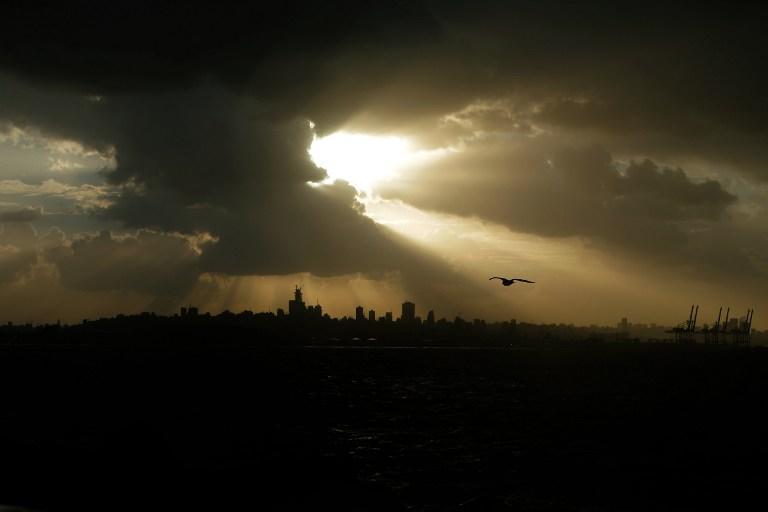 Heavy clouds cover the skies over the Lebanese capital, Beirut on January 7, 2013. Stormy weather, including high winds and heavy rainfall, lashed the eastern Mediterranean coast, downing power lines and trees and causing several injuries in a number of countries. AFP PHOTO /JOSEPH EID