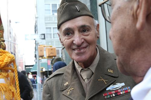 WWII veteran Eugene Cannava, 86, from New York, left, chats with Korean War veteran Samuel Benchimol, 81, from Glen Head, N.Y., as they wait to march up New York's Fifth Avenue in the Veterans Day Parade Sunday Nov. 11, 2012. (AP Photo/Tina Fineberg)