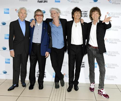 "FILE - This Oct. 18, 2012 file photo shows, from left, Charlie Watts, Bill Wyman, Keith Richards, Ronnie Wood and Mick Jagger of The Rolling Stones at London Film Festival American Express Gala for their film, ""The Rolling Stones - Crossfire Hurricane"" at Odeon West End in London. The archetypal rock 'n' roll band is set for five concerts in London and the New York area over the next month, released another hits compilation with two new songs on Tuesday, Nov. 13, and will see HBO premiere a documentary on their formative years, ""Crossfire Hurricane,"" on Thursday Nov. 15. Wyman was a member of the band until 1993. (Photo by Jon Furniss/Invision/AP, file)"