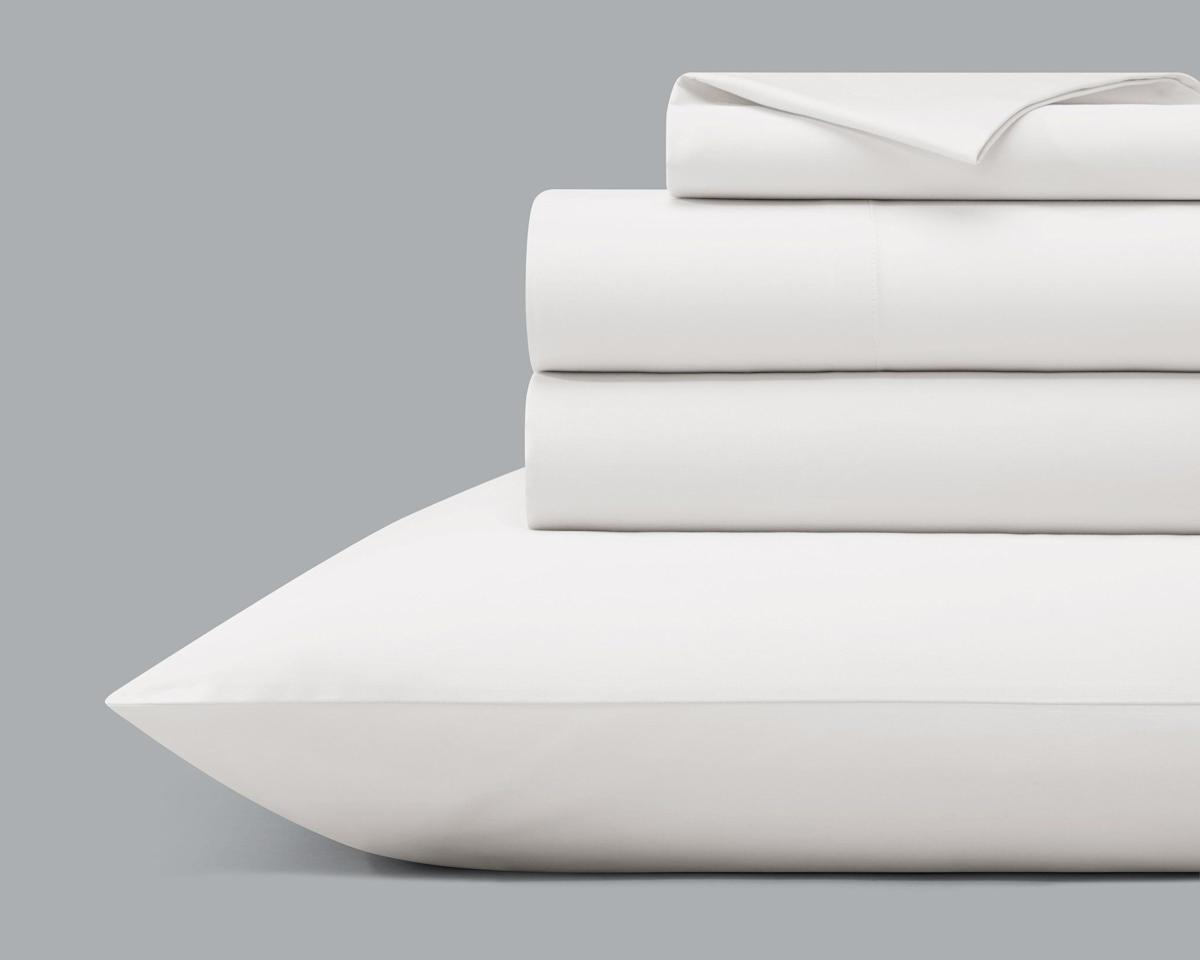 "<p><strong>Hülyahome</strong></p><p>hulyahome.com</p><p><strong>$99.00</strong></p><p><a href=""https://hulyahome.com/products/the-percale-sheet-set?variant=31440678158421"" target=""_blank"">Shop Now</a></p><p>Not only are these cool cotton sheets expertly tailored, they're also organic and Fair Trade–certified.</p>"