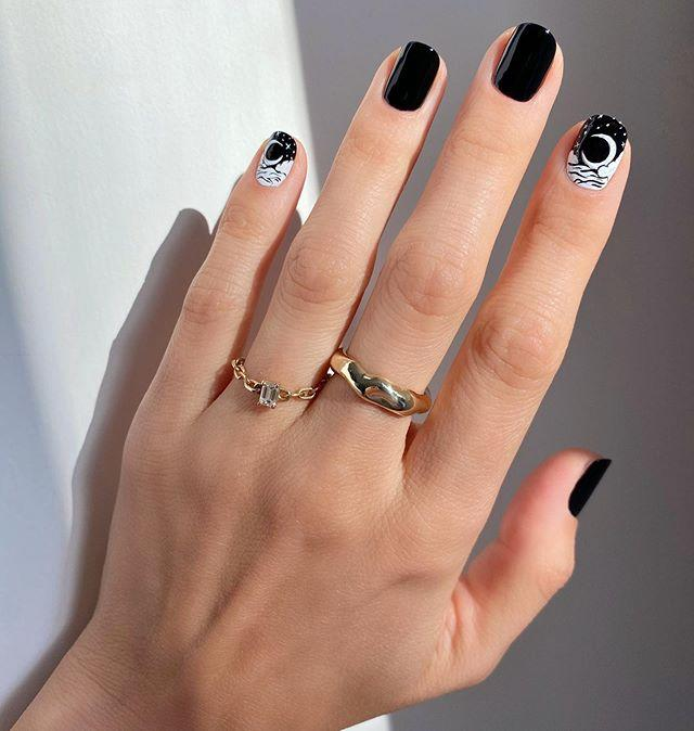 "<p>This manicure by Betina Goldstein combines our two favourite things: black nail polish and half moons.</p><p><a href=""https://www.instagram.com/p/CF4kUQIjeJK/"">See the original post on Instagram</a></p>"