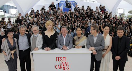From left, jury members Lynne Ramsay, Ang Lee, Steven Spielberg, Nicole Kidman, Daniel Auteuil, Vidya Balan, Christoph Waltz, Naomi Kawase and Cristian Mungiu pose for photographers during a photo call for the jury at the 66th international film festival, in Cannes, southern France, Wednesday, May 15, 2013. (AP Photo/Francois Mori)