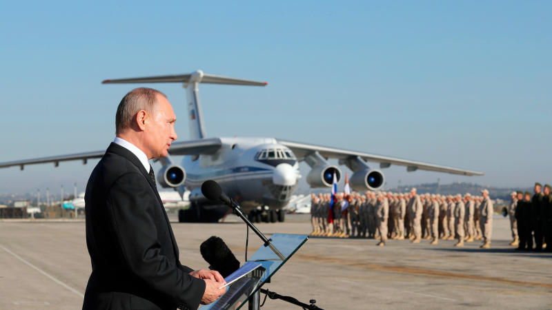 FILE - In this Dec. 12, 2017, file photo, Russian President Vladimir Putin addresses the troops at the Hemeimeem air base in Syria. A summit meeting between the Turkish and Russian leaders scheduled for Thursday, March 5, 2020, may be the last chance to work out a deal that avoids a calamity in Syria's northwest. Faced with mounting losses for his troops in Syria and a potential wave of refugees fleeing fighting in northwestern Syria, Turkish President Recep Tayyip Erdogan is eager for a cease-fire and Vladimir Putin is ready to bargain. (Mikhail Klimentyev/Pool Photo via AP, File)