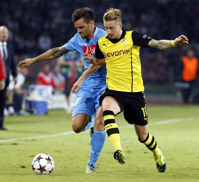 Napoli's Maggio and Borussia Dortmund's Reus fight for the ball during their Champions League Group F soccer match in Naples