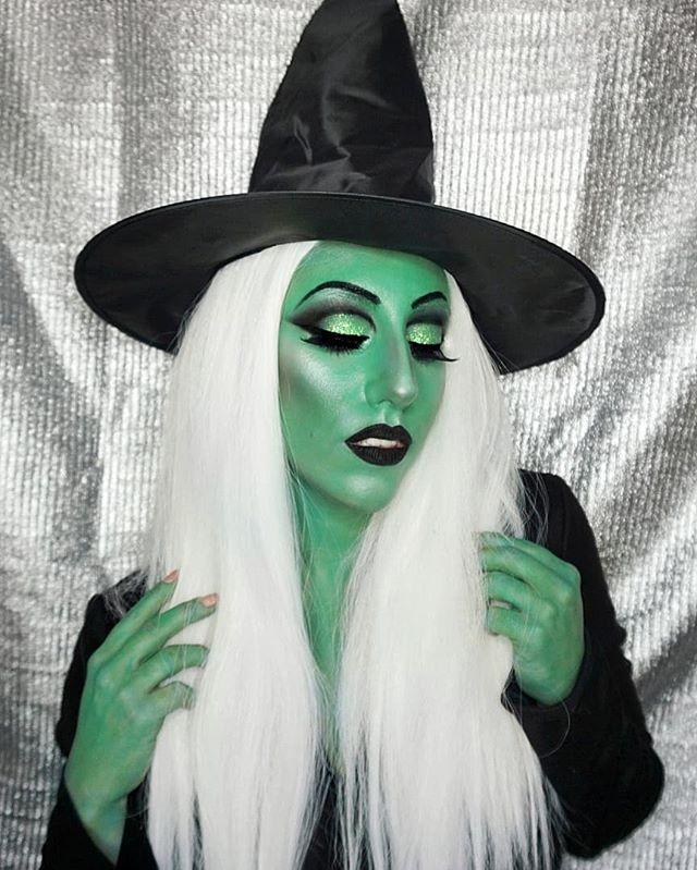 """<p>Make all the other witches green with envy. Take note of the jet-black lips and eyebrows, shimmery accents, and the same green makeup on the hands to complete the wicked witch look.</p><p><a class=""""body-btn-link"""" href=""""https://www.amazon.com/Rimmel-Matte-Liquid-Pitch-Black/dp/B0728D3PTH/?tag=syn-yahoo-20&ascsubtag=%5Bartid%7C10050.g.34102125%5Bsrc%7Cyahoo-us"""" target=""""_blank"""">SHOP BLACK LIPSTICK</a></p><p><a href=""""https://www.instagram.com/p/B3-NcVIgONj/?utm_source=ig_embed&utm_campaign=loading"""">See the original post on Instagram</a></p>"""