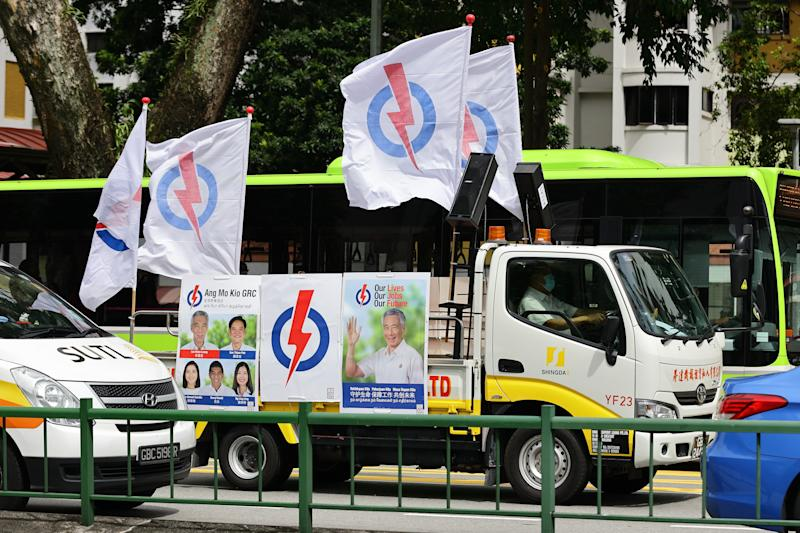 A People's Action Party vehicle fitted with loudspeakers to deliver pre-recorded campaigning messages is seen on the road on 30 June, 2020 in Singapore. (PHOTO: Getty Images)