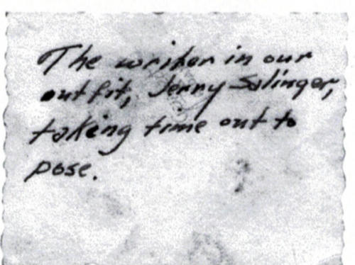 "This undated image provided by The Story Factory shows a note written on the back of a photo showing J.D. Salinger working on ""Catcher in the Rye"" during World War II. Shane Salerno, a screenwriter, has taken on a surprising and news-making identity: the latest, and, apparently, greatest seeker of clues about J.D. Salinger.(AP Photo/The Story Factory, Paul Fitzgerald)"