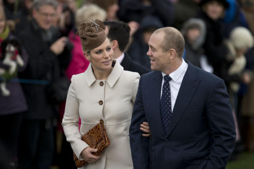 Britain's Queen Elizabeth II's granddaughter Zara Phillips and her husband rugby player Mike Tindall arrive for the British royal family's traditional Christmas Day church service in Sandringham, England, Tuesday, Dec. 25, 2012. (AP Photo/Matt Dunham)
