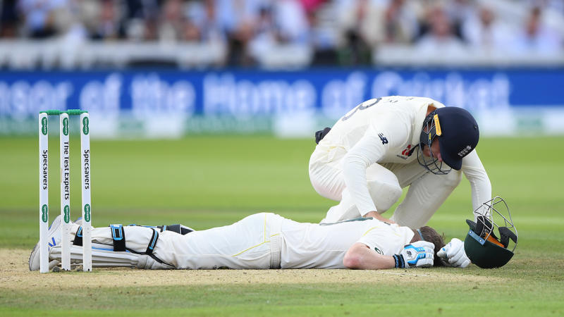 England fielder Jos Buttler rushes to the aid of Australia batsman Steve Smith after he is hit on the helmet by a ball from Jofra Archer during day four of the 2nd Test Match. (Photo by Stu Forster/Getty Images)