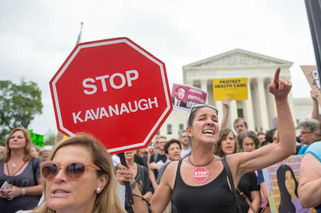 Demonstrators protest the imminent confirmation of Supreme Court nominee Brett Kavanaugh at the Supreme Court on Oct. 6. (Photo: RobertoSchmidt/AFP/Getty Images)
