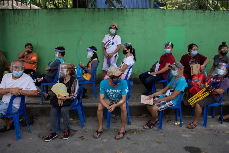 Philippines urges virus vigilance after lowest cases in eight weeks