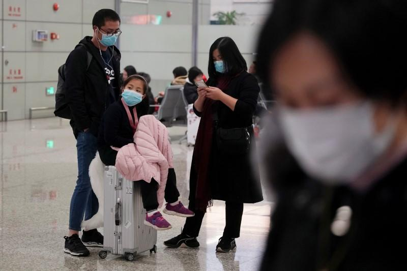 Passengers wearing masks are seen at Hongqiao International Airport in Shanghai