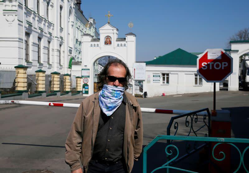 FILE PHOTO: A man walks in front of the gate of the Kiev Pechersk Lavra monastery in Kiev