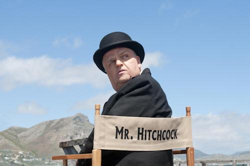 """This image released by HBO shows Toby Jones, portraying Alfred Hitchcock in a scene from the film """"The Girl,"""" premiering Saturday, Oct. 20, 2012 at 9 p.m. EST. The HBO movie dramatizes the making of Hitchcock's """"The Birds"""" and his relationship with actress Tippi Hedren. (AP Photo/HBO, Kelly Walsh)"""