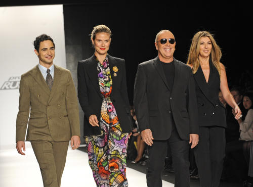 Project Runway judges, from left, Zac Posen, Heidi Klum, Michael Kors and Nina Garcia greet guests before the showing of the finalists Fall 2013 collection during Fashion Week, Friday, Feb. 8, 2013 in New York. (AP Photo/Louis Lanzano)