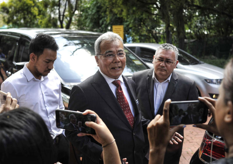 Minister in the Prime Minister's Department Datuk Seri Mohd Redzuan Md Yusof (centre) is said to have been present at a post-Cabinet meeting last Friday that was also attended by the auditor-general who later tested positive for Covid-19. — File picture by Shafwan Zaidon