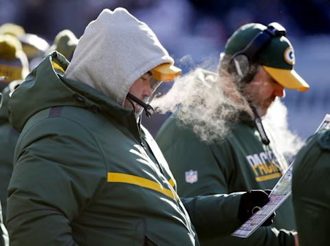 Expect plenty of bundled up coaches for the New York Giants-Green Bay Packers game. (AP)
