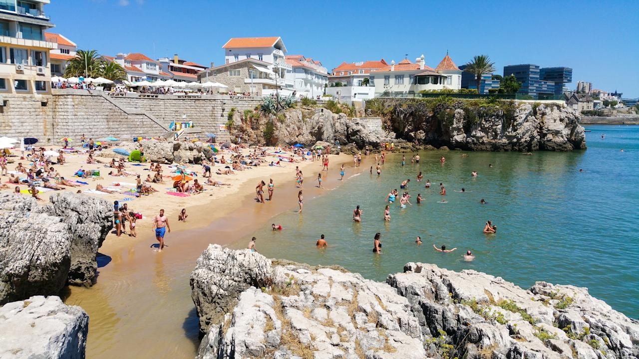 """While everyone else is getting pushed around by the crowds in Lisbon, you can get a little slice of coastal calm in Cascais. This historic fishing village is just over 30km west of the Portuguese capital, yet it feels a world away with its trio of golden bays, winding lanes and great surfing waves. B&B doubles at <a href=""""https://www.thealbatrozcollection.com/albatrozhotel/the-albatroz-hotel"""">The Albatroz Hotel</a> cost from €295 per night."""