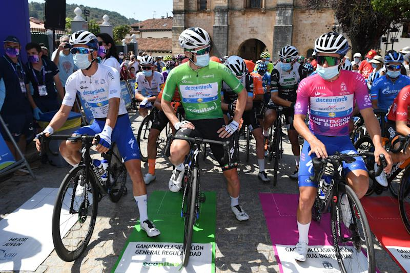 LAGUNAS DE NEILA SPAIN AUGUST 01 Start Joo Almeida of Portugal and Team Deceuninck QuickStep White Best Young Jersey Sam Bennett of Ireland and Team Deceuninck QuickStep Green Points Jersey Remco Evenepoel of Belgium and Team Deceuninck QuickStep Purple Leader Jersey Gotzon Martin Sanz of Spain and Team EuskaltelEuskadi Red Mountain Jersey Covarrubias Village Peloton during the 42nd Vuelta a Burgos 2020 Stage 5 a 158km stage from Covarrubias to Lagunas de Neila 1872m VueltaBurgos on August 01 2020 in Lagunas de Neila Spain Photo by David RamosGetty Images