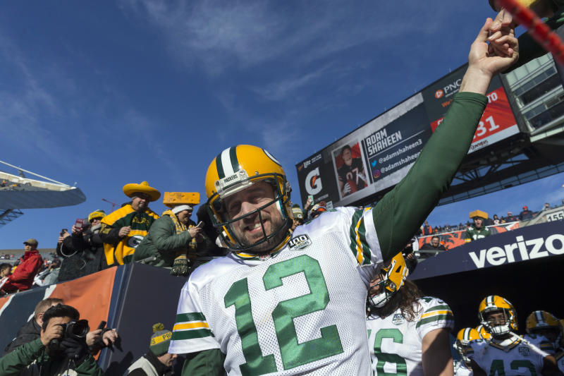 Dec 16, 2018; Chicago, IL, USA; Green Bay Packers quarterback Aaron Rodgers (12) greets a fan while taking to the field before their game against the Chicago Bears at Soldier Field. Mandatory Credit: Mark Hoffman/Milwaukee Journal Sentinel via USA TODAY NETWORK