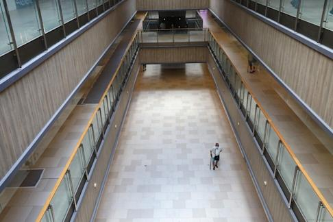An elderly man in a face mask walks alone in a deserted shopping centre in Tsz Wan Shan amid the third wave of coronavirus infections on 14 August 2020. Photo: Dickson Lee